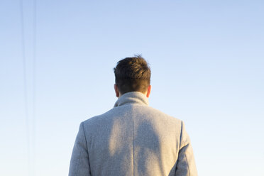 Back view of young man against sky - AFVF00174