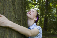 A young woman hugging a tree - FSIF02692