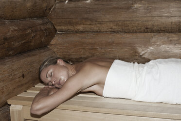 A woman lying on her front in a sauna - FSIF02743