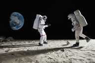 Two astronauts playing soccer on the moon - FSIF02764