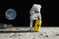 An astronaut rolling a drum of toxic material on the moon surface - FSIF02767