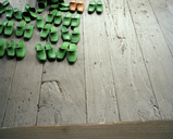 Pairs of slippers on a wooden floor - FSIF02797