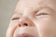 A baby boy crying, extreme close up of face - FSIF02859
