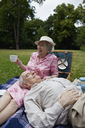 Senior couple have relaxing picnic in the park - FSIF02880