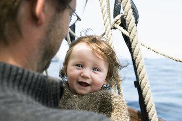 An excited baby with her father on a boat - FSIF02916