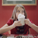 A teenage girl holding a mug of hot chocolate - FSIF02943