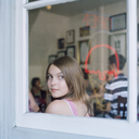 A teenage girl looking through a cafe window - FSIF02946