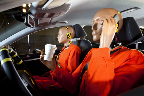 A crash test dummy carelessly using a mobile phone while driving with a crash test dummy passenger - FSIF03009