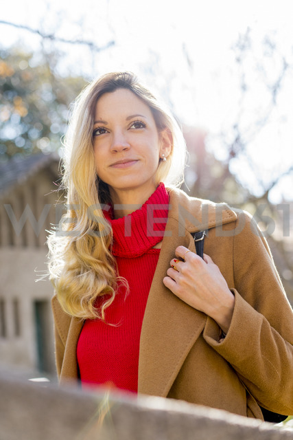 Portrait of smiling young woman in a public garden - AFVF00177
