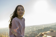 Portrait of smiling young woman on a hill - AFVF00212