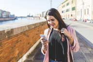 Young businesswoman with her smartphone in the city - WPEF00135