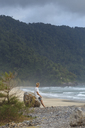 Indonesia, Sumatra, young man at ocean coastline - KNTF00975