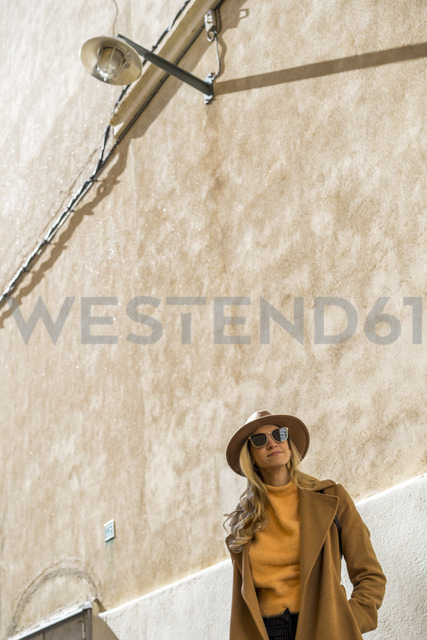 Portrait of fashionable young woman at a building - AFVF00236