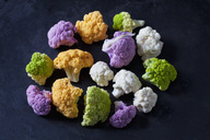 Coloured cauliflower florets on dark background - CSF28942