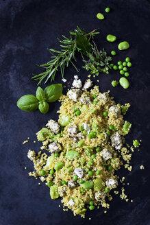 Quinoa salad with broad beans, peas and feta on dark metal - CSF28975