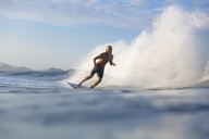 Indonesia, Sumatra, happy man surfing - KNTF00980