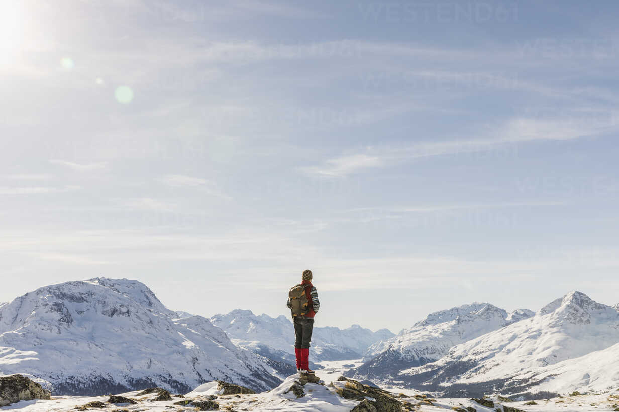 Switzerland, Engadin, hiker in mountainscape looking at view - MRAF00259 - Michela Ravasio/Westend61