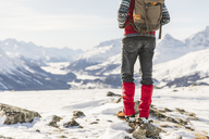 Switzerland, Engadin, lowsection of hiker standing in mountainscape - MRAF00262