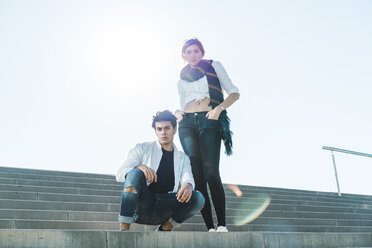 Portrait of stylish young couple on stairs outdoors - AFVF00258