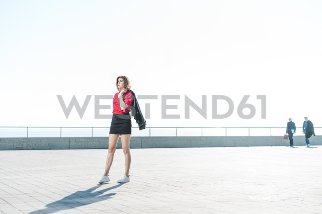 Fashionable young woman on waterfront promenade - AFVF00267