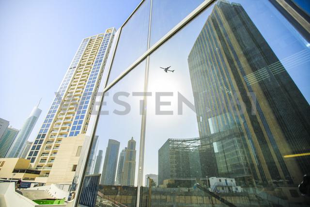 United Arab Emirates, Dubai, mirrored airplane in glass facade - ZEF15013