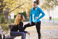 Two sportive young women talking in park - JSRF00019