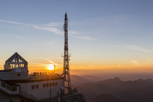Austria, Germany, Bavaria, Zugspitze, mountain station, observation deck, aerial mast at sunset - FO09849