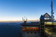 Austria, Germany, Bavaria, Zugspitze, mountain station, observation deck, aerial mast, restaurant in the evening - FO09852
