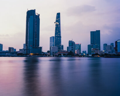 Vietnam, Ho Chi Minh City, Skyline at sunset - MADF01400