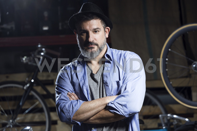 Portrait of serious man in bicycle workshop - JSRF00039