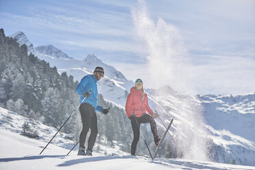 Austria, Tyrol, Luesens, Sellrain, two cross-country skiers in snow-covered landscape - CVF00157