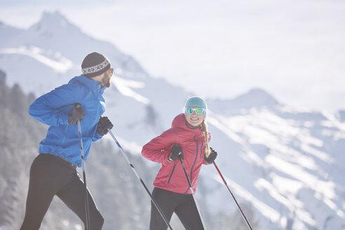 Austria, Tyrol, Luesens, Sellrain, two cross-country skiers having a break - CVF00160