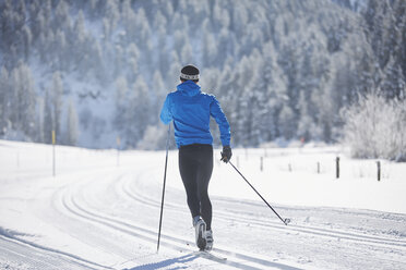 Austria, Tyrol, Luesens, Sellrain, cross-country skier in loipe in snow-covered landscape - CVF00163