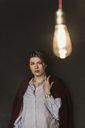Young woman with illuminated light bulb - UUF12827
