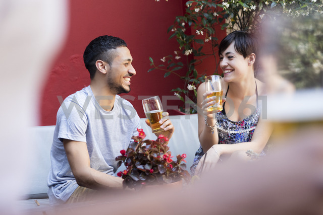 Happy couple having a beer outside - LFEF00085