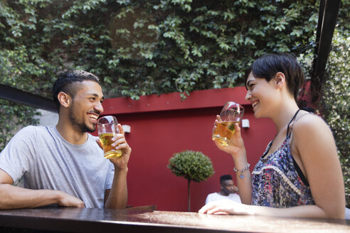 Happy couple having a beer outside - LFEF00088