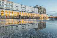 Germany, Hamburg, Kleine Alster with Alsterarkaden in the evening, mirrored in puddle - KEBF00753