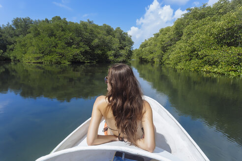 Indonesia, Bali, Lembongan island, woman on a boat trip - KNTF01027