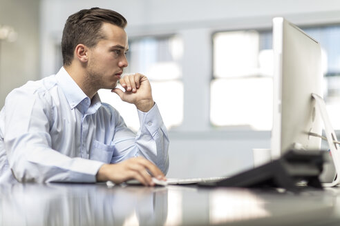 Businessman working on computer at desk in office - ZEF15076
