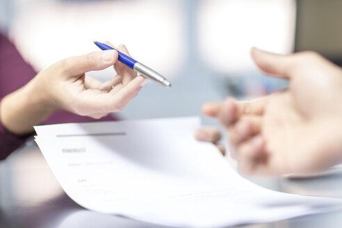 Handing over of a pen over document - ZEF15082