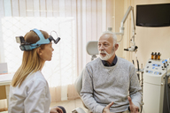 ENT physician talking to senior man in medical practice - ZEDF01233