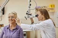 ENT physician examining ear of a senior woman - ZEDF01239