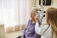 ENT physician examining ear of a senior woman - ZEDF01242