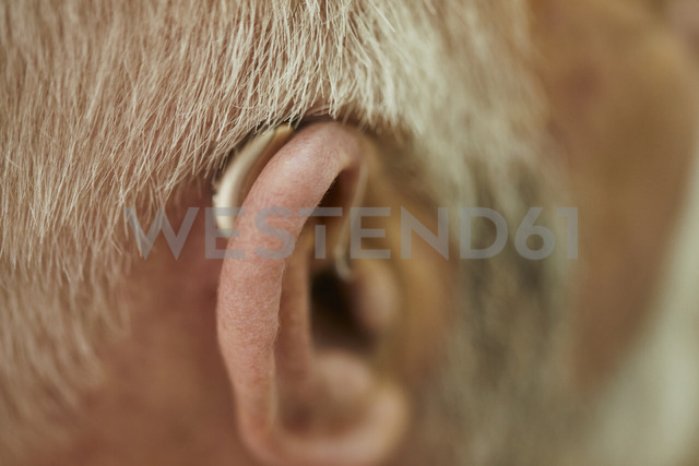 Close-up of senior man with hearing aid - ZEDF01254