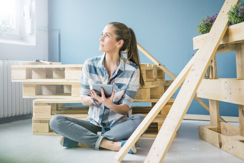 Beautiful woman planning to refurbish her home with pallets - MOEF00872