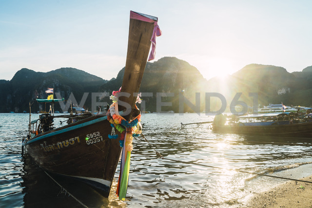 Thailand, Phi Phi Islands, Ko Phi Phi, moored long-tail boat in backlight - KKAF00875