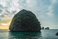 Thailand, Phi Phi Islands, Ko Phi Phi, island in the sea at sunset - KKAF00887