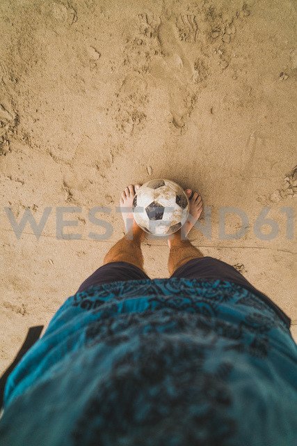 Low section of man with footall on the beach - KKAF00899