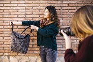 Fashion designers doing a photo shoot of their new products - JRFF01559