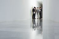 Business people meeting in corridor - CAIF00017
